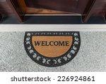 welcome door mat with open door  | Shutterstock . vector #226924861