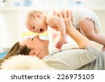 mother and baby hugging and...   Shutterstock . vector #226975105