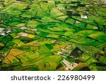 Aerial View Of Green Farmland...