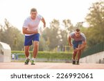 two runners racing on track | Shutterstock . vector #226992061