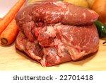raw roast beef on cutting board ...
