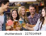 young friends having a drink...   Shutterstock . vector #227014969