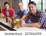 young men drinking beer... | Shutterstock . vector #227016259