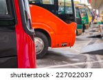 Row of colourful parked buses. - stock photo