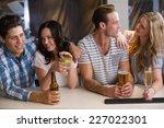 happy friends having a drink... | Shutterstock . vector #227022301