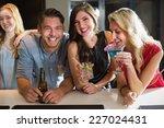 happy friends having a drink... | Shutterstock . vector #227024431