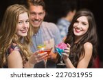 happy friends having a drink... | Shutterstock . vector #227031955