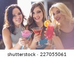 attractive friends drinking... | Shutterstock . vector #227055061