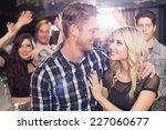 Stylish Couple Smiling And...
