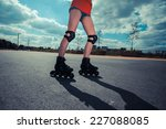 a young woman is rollerblading... | Shutterstock . vector #227088085