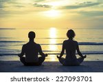 Young Couple Practicing Yoga In ...