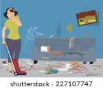 shocked woman with vacuum... | Shutterstock .eps vector #227107747