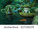 A Lantern And Waterfall In The...