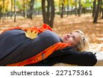 Pregnant Woman Lay In Autumn...