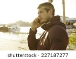 handsome muscle man talking on... | Shutterstock . vector #227187277