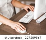 female hand on a computer mouse | Shutterstock . vector #227209567