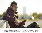 attractive man in hoodie... | Shutterstock . vector #227229214
