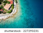 sea shore and building roof at... | Shutterstock . vector #227293231