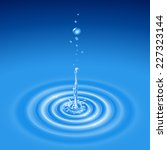 the drop falls in water and...   Shutterstock .eps vector #227323144