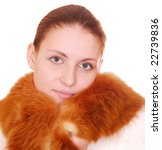 beauty woman in fur coat over white - stock photo