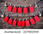 many empty red tags hanging on... | Shutterstock . vector #227402545