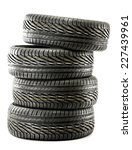 four new black tires isolated... | Shutterstock . vector #227439961