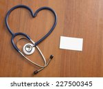 a male doctor at his workplace  ... | Shutterstock . vector #227500345