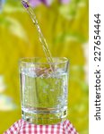 glass of water on nature...   Shutterstock . vector #227654464