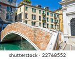 red brick bridge over a canal in Venice, Italy - stock photo