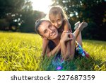 mother and daughter in the park | Shutterstock . vector #227687359