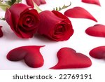 Two beautiful red roses with hearts on a white background - stock photo