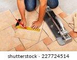 installing ceramic floor tiles  ... | Shutterstock . vector #227724514