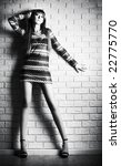 young sexy woman on brick wall... | Shutterstock . vector #22775770