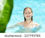 Beautiful Blond Woman Swimming...