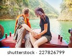 Couple Traveling By Boat  Back...