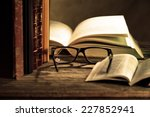 reading glasses with books on... | Shutterstock . vector #227852941