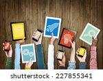 group of hands holding digital... | Shutterstock . vector #227855341