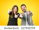 couple doing the horn sign over ... | Shutterstock . vector #227920759