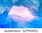 Blue Ice Cave Covered With Sno...