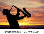Saxophonist. Man Playing On...