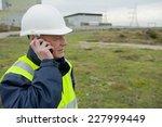 construction worker on telephone | Shutterstock . vector #227999449