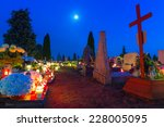 GORNA GRUPA, POLAND - NOV 1, 2014: Cemetary at night with colorful candles for All Saints Day in Poland. All Saints' Day is a solemnity celebrated on 1 November by the Catholic Church. - stock photo