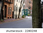 an old new england neighborhood, selective focus is on the tree in the foreground
