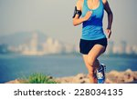 runner athlete running at... | Shutterstock . vector #228034135