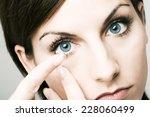 close up  girl inserting... | Shutterstock . vector #228060499