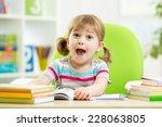 happy kid girl reading book at... | Shutterstock . vector #228063805