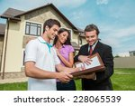 young man signing renting...   Shutterstock . vector #228065539
