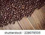 coffee beans on wooden... | Shutterstock . vector #228078535