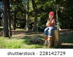 girl sitting on the stump | Shutterstock . vector #228142729