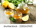 green tea in cup and teapot on... | Shutterstock . vector #228161965